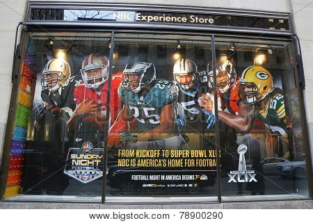 NBC Experience Store window display decorated with NFL and Super Bowl XLIX logos