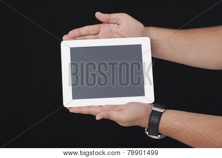 Holding A White Digital Tablet With bots Hands on the Black Background
