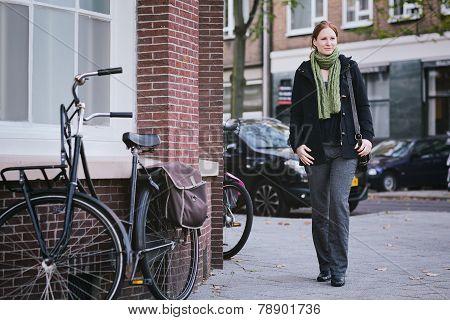 Woman Walking On A European Street