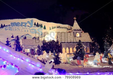 Merry Christmas And Village Scene With Church