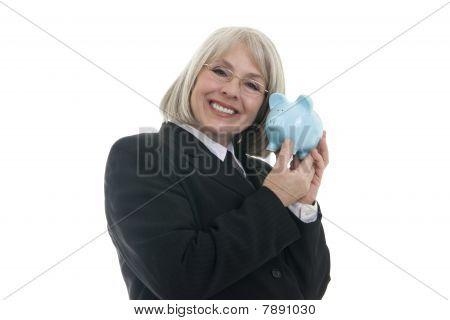 Cute Business Woman Holding A Piggy Bank
