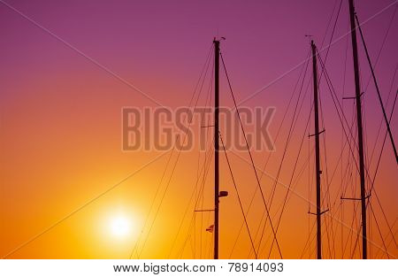 Boat Masts Silhouette On A Colorful Night