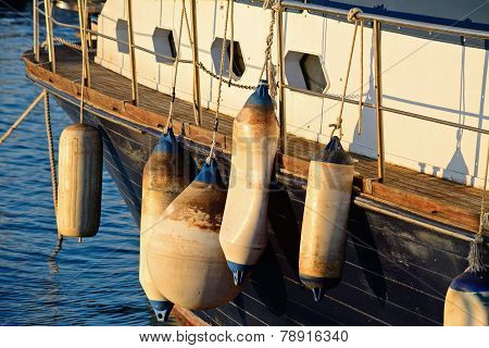 Several Fender On A Wooden Boat