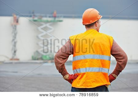 Adult construction manager or building site foreman worker