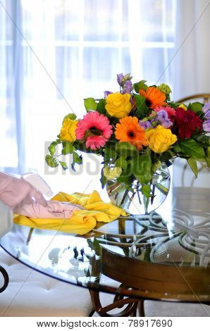 Cleaning house flowers on table