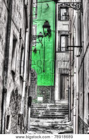 Narrow Backstreet In Bosa Old Town In Selective Desaturation