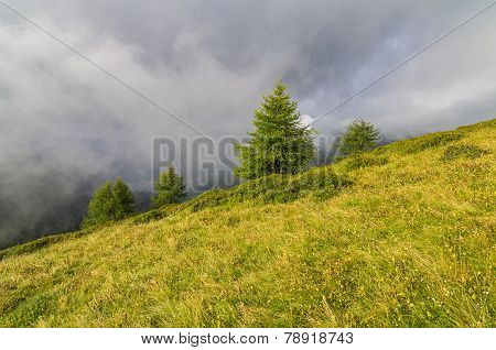 Low Clouds In The Mountains. Alps, Italy.