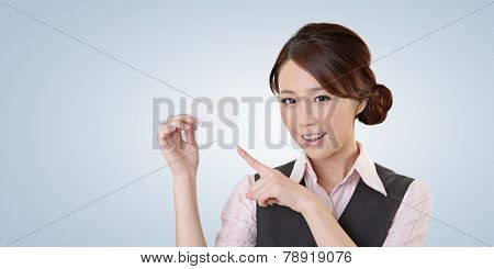 Cheerful business woman holding blank business card, closeup portrait with clipping path.