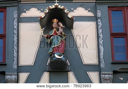 MILTENBERG, GERMANY - 20 JULY: Madonna with child Jesus, statue on the main street of Miltenberg in Lower Franconia, Bavaria, Germany, on July 20, 2013