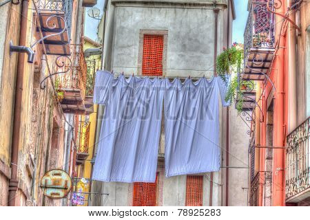 Laundry Line With Bed Sheets In Bosa Old Town, Sardinia