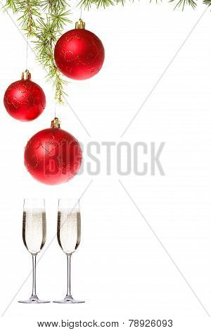 Decoration With Red Ornamentals And Green Fir Tree On White Surface With Two Glasses Of Champagne