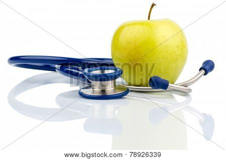 an apple and a stethoscope with a doctor. symbolic photo for healthy, vitamin-rich diet.