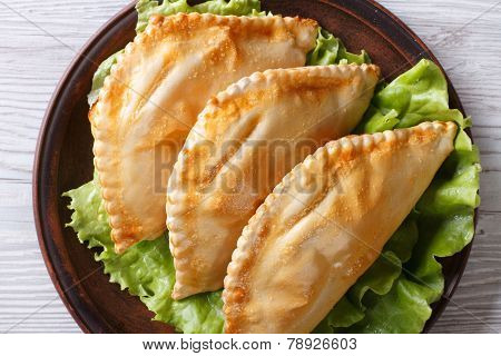 Empanadas On A Plate Close-up. Horizontal View From Above