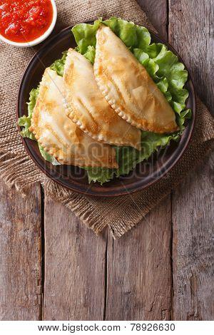 Empanadas And Sauce Closeup. Vertical Top View, Rustic