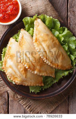 Traditional Empanadas And Sauce Closeup. Vertical Top View