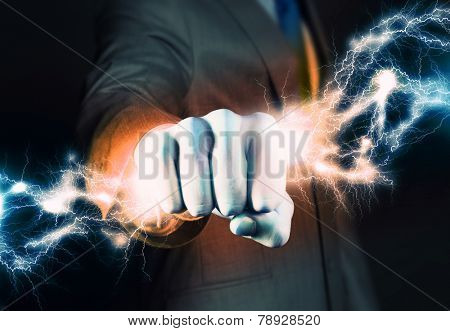 Close up of businessman grasping lightning in hand