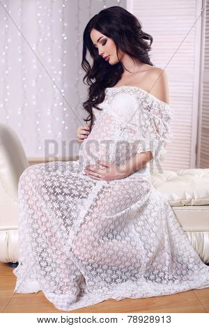 Beautiful Pregnant Woman With Dark Hair Wearing Lace Dress