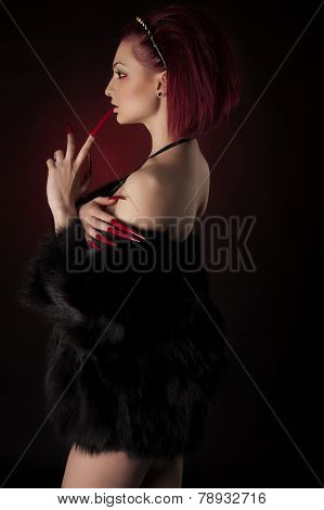 Beautiful Woman With Red Hair And Long Nails