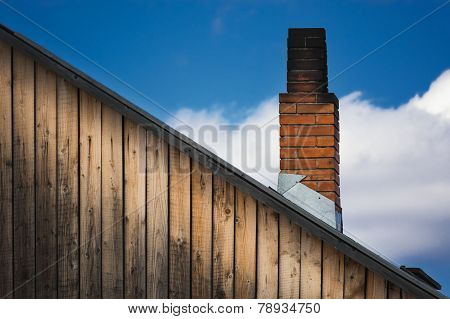 The Old Brick Chimney On The Roof