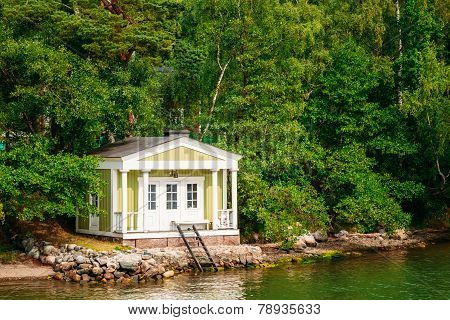 Yellow Finnish Wooden Bath Sauna Log Cabin On Island In Summer