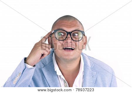 man thinking while doing a silly face with nerd glasses isolated on white