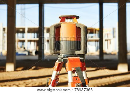 Rotating laser levelling equipment at construction building area
