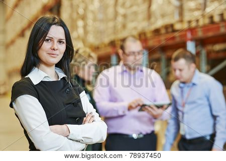 female manager and workers in warehouse