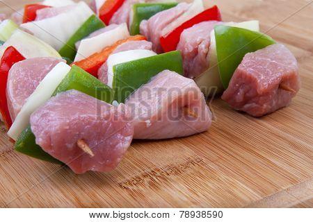 Shashlik with bacon, paprika, onion