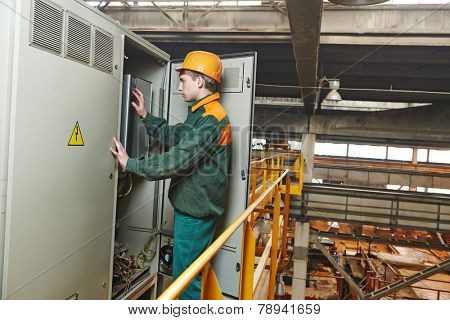 electrician builder engineer switching actuator equipment in distribution fuse box at factory