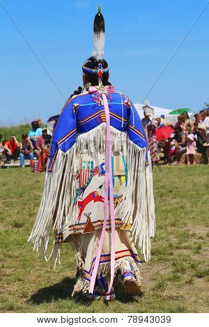 Unidentified female Native American dancer wears traditional Pow Wow dress during the NYC Pow Wow