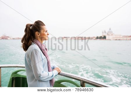 Young Woman Travel By Vaporetto In Venice, Italy And Looking On Copy Space
