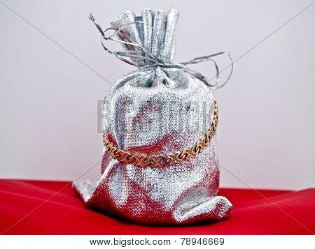 Bracelet gift against red carpet