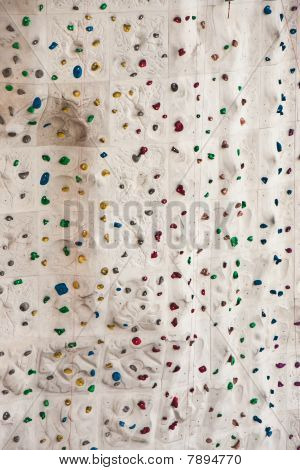 Rock Climbing Wall With Colorful Foot And Hand Holds