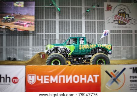 MOSCOW, RUSSIA - MAR 29, 2014: Green jeep with huge wheels, participant show Monster X Tour in Olympic Sports Complex