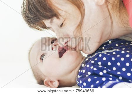 Mother And Her Newborn Little Child Communicating Together.