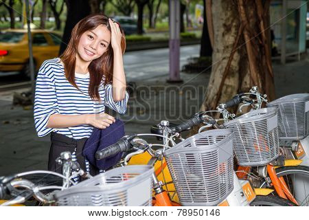 Chinese Woman By Rental Bikes In Taipei City