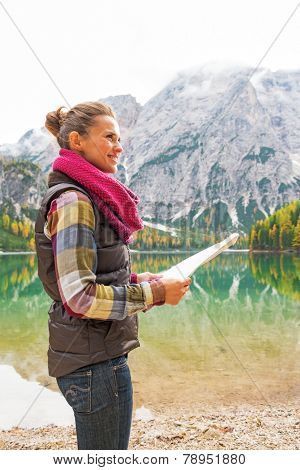 Happy Young Woman With Map On Lake Braies In South Tyrol, Italy