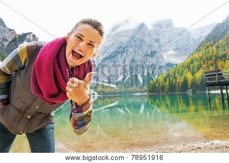 Happy Young Woman On Lake Braies In South Tyrol, Italy Showing T