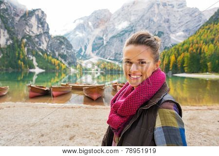 Portrait Of Happy Young Woman On Lake Braies In South Tyrol, Italy