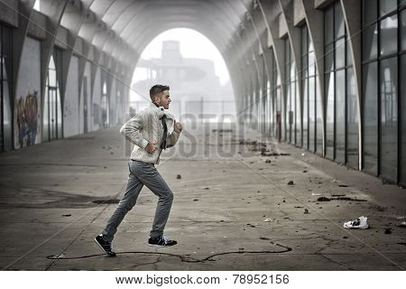 Man Running Through Abandoned Tunnel