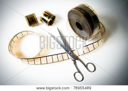 35Mm Movie Reel And Scissors For The Final Cut