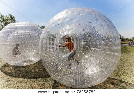 Children Have Fun In The Zorbing Ball