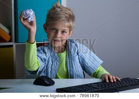 Boy Throwing Ball Of Paper