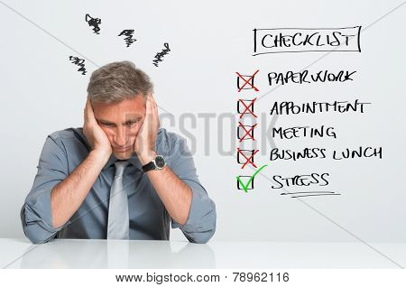 Portrait Of Stressed Businessman With Too Many Tasks To Do At Office