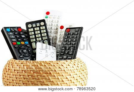 Many remote control devices in container isolated on white
