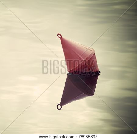 Red Buoy In The Water In Vintage Tone