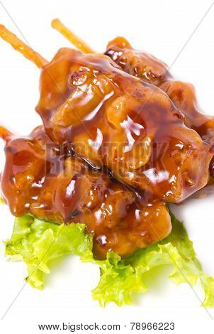 Chicken teriyaki with skewers isolated on white