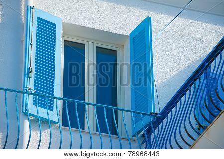 Blue Window And Railing