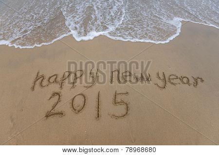 happy new year 2015 written in sand