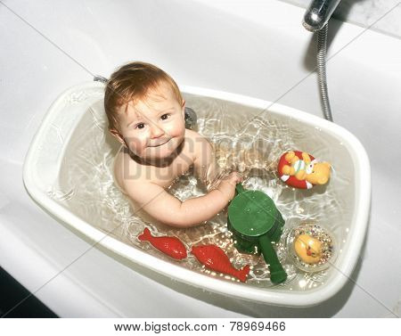 Baby Plays In His Plastic Bath
